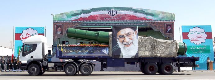 A military truck carrying a missile and a picture of Iran's Supreme Leader Ayatollah Ali Khamenei. Reuters