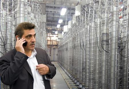 FILE PHOTO: An official from Iran's Atomic Energy Organization speaks on his mobile phone in front of uranium enriching centrifuges. REUTERS/Caren Firouz