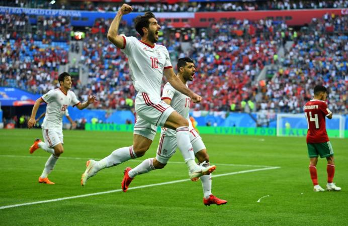 File photo: Soccer Football - World Cup - Group B - Morocco vs Iran - Saint Petersburg Stadium, Saint Petersburg, Russia - June 15, 2018 Iran's Karim Ansarifard and Mehdi Taremi celebrate their first goal REUTERS/Dylan Martinez