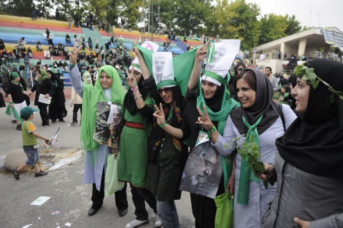 Female voters supporting Hossein Moussavi for the presidency during the Green Movement.