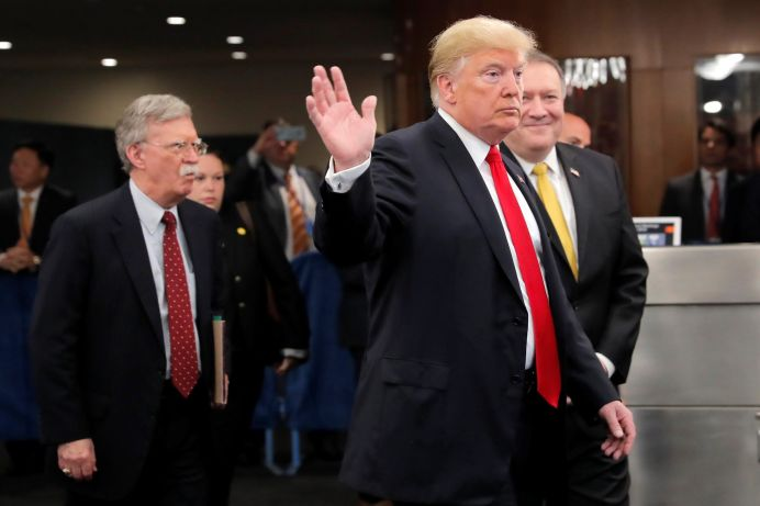 FILE PHOTO: U.S. President Donald Trump arrives at United Nations headquarters with Secretary of State Mike Pompeo (R) and National Security Advisor John Bolton (L) during the 73rd United Nations General Assembly in New York, U.S., September 24, 2018. REUTERS/Caitlin Ochs