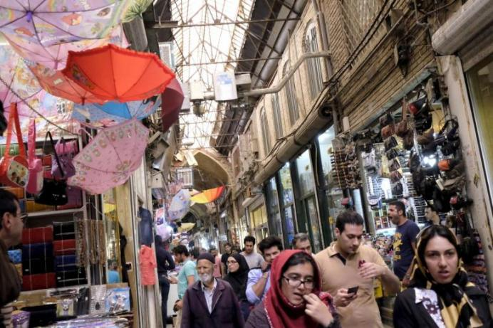 People walk at the Grand Bazaar in central Tehran October.REUTERS