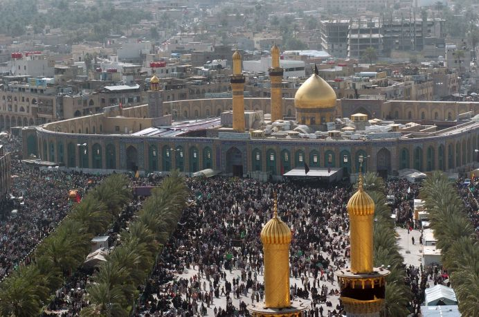 Millions of Shia Muslims gather around the Husayn Mosque in Karbala after making the Pilgrimage on foot during Arba'een