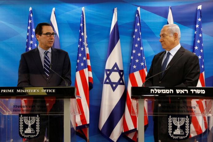 Benjamin Netanyahu (R) and Steven Mnuchin October 21, 2018. REUTERS