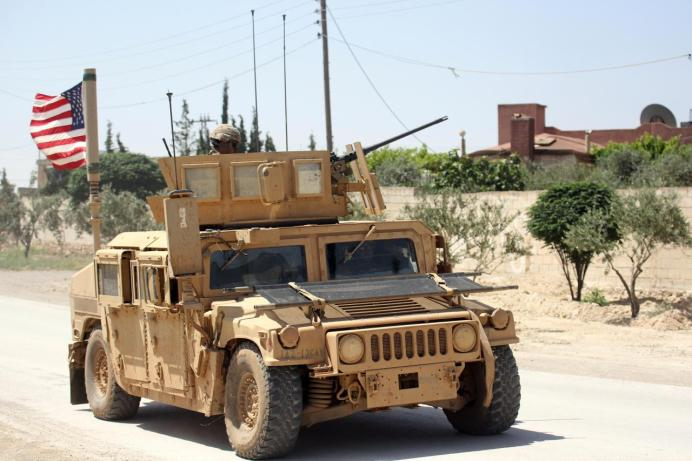 The U.S. flag flutters on a military vehicle in Syria. REUTERS/Aboud Hamam/