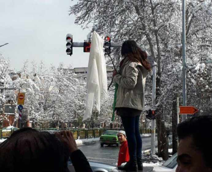 Others joined Vida Movahed by removing their scarfs in public. Source: Kayhan London