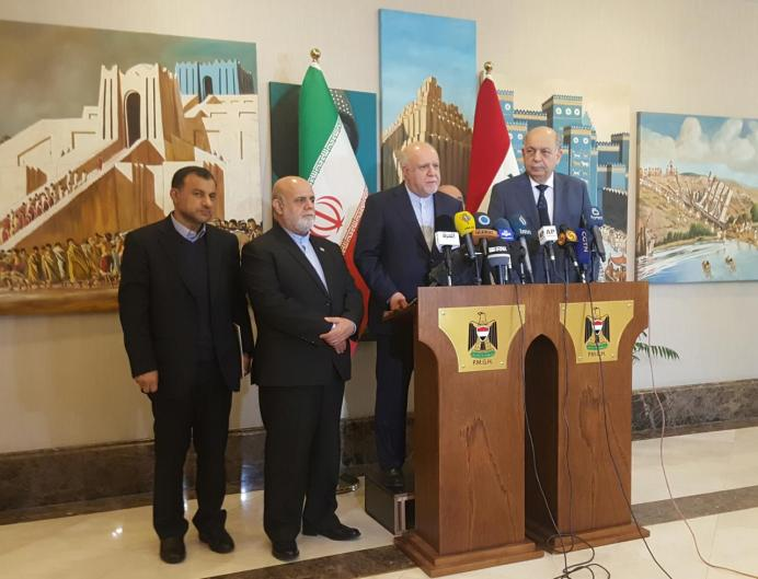 FILE PHOTO: Iran's Oil Minister Bijan Zanganeh and Iraqi Oil Minister Thamer al-Ghadhban attend a news conference in Baghdad, Iraq January 10, 2018. REUTERS/Ahmed Rasheed