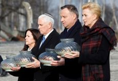 U.S. Vice President Mike Pence with his wife Karen and Poland's President Andrzej Duda with first lady Agata Kornhauser-Duda carry candles at the Monument to the Victims at the former Nazi German concentration and extermination camp Auschwitz II-Birkenau, near Oswiecim, Poland, February 15, 2019. REUTERS/Kacper Pempel