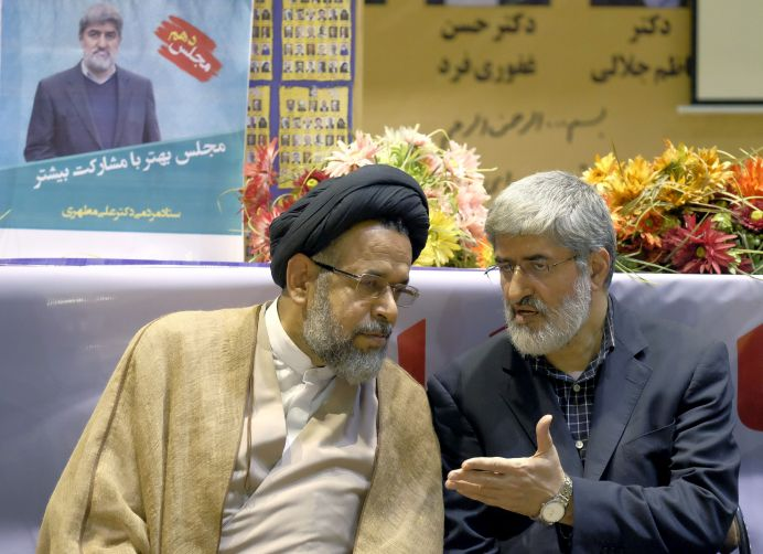 FILE PHOTO: Ali Motahari (R), talks to Iran's Minister of Intelligence Mahmoud Alavi. REUTERS/Raheb Homavandi