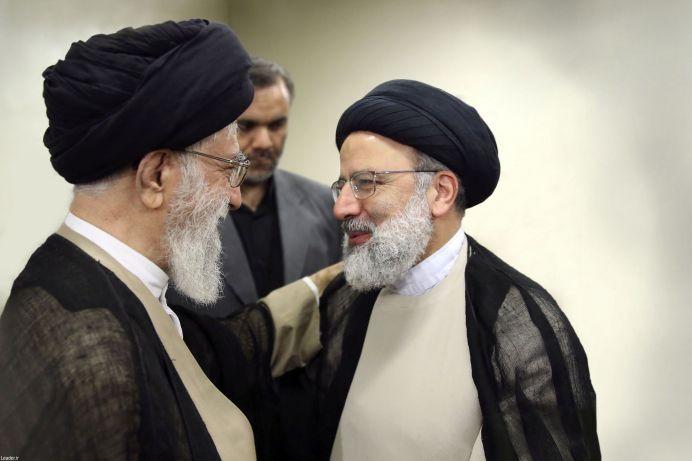 Iranian Supreme Leader Ayatollah Khamenei (L)talks to Ebrahim Raisi (R). REUTERS