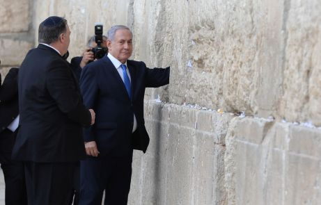 Israeli Prime Minister Benjamin Netanyahu touches the stones of the Western Wall during a visit together with U.S. Secretary of State Mike Pompeo to the site in Jerusalem's Old City March 21, 2019. Abir Sultan/ Pool via REUTERS