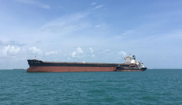 FILE PHOTO: Capesize dry-bulk ship, the Great Tang, takes on bunker fuel in the Singapore Strait from the Kantek 2 bunker barge December 17, 2017. REUTERS
