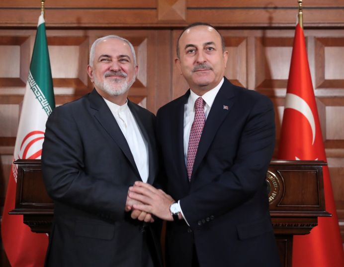 FILE PHOTO: Turkish Foreign Minister Mevlut Cavusoglu (R) with his Iranian counterpart Mohammad Javad Zarif (L). REUTERS./