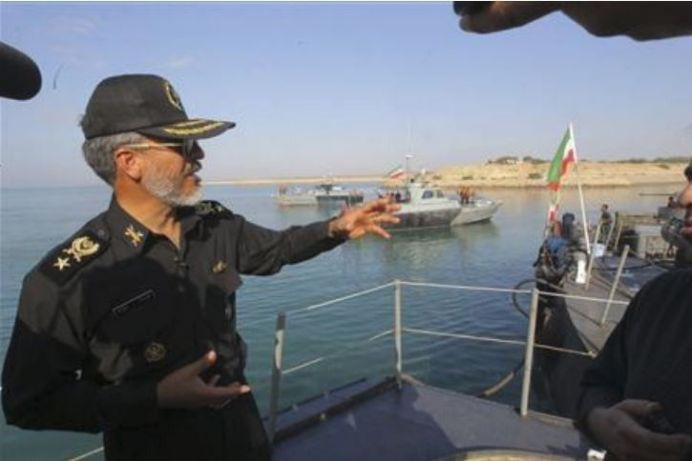 FILE PHOTO: An Iranian navy commander Habibollah Sayyari (L) gestures as he speaks with media on Sea of Oman near the Strait of Hormuz in southern Iran. Reuters