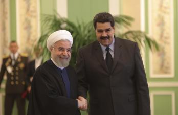Venezuela's President Nicolas Maduro (R) is welcomed by Iran's President Hassan Rouhani in Tehran January 10, 2015. REUTERS
