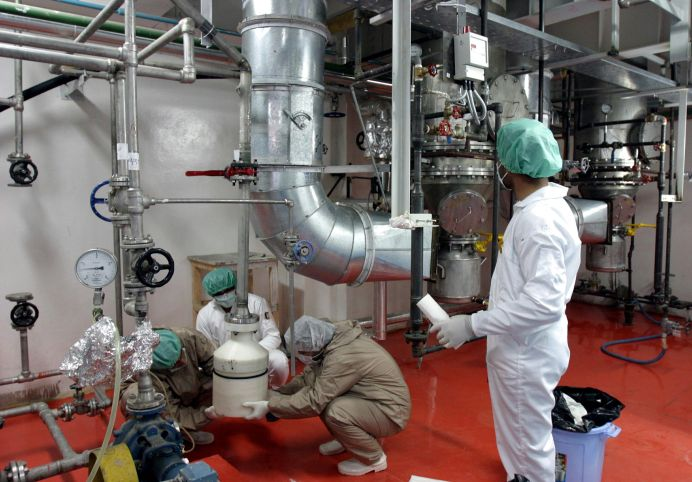 FILE PHOTO: Employees work in the Natanz nuclear facility 300 kilometers south of Tehran. Reuters