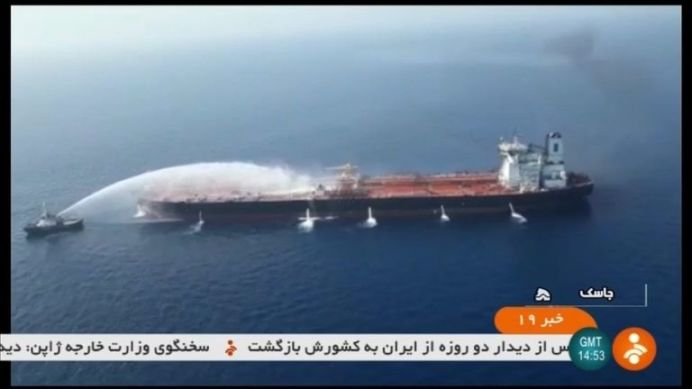 Firefighters tackle tanker ablaze at sea. REUTERS