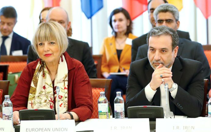FILE PHOTO: Iran's top nuclear negotiator Abbas Araqchi and Secretary General of the European External Action Service (EEAS) Helga Schmit attend a meeting of the JCPOA Joint Commission in Vienna, Austria, June 28, 2019. REUTERS/Leonhard Foeger