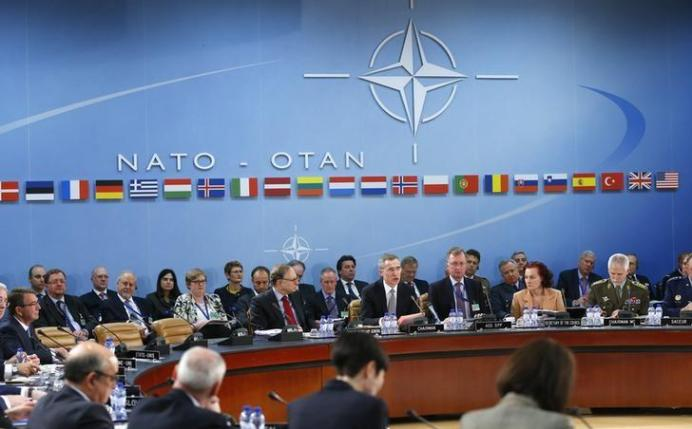 FILE PHOTO: NATO Secretary General Jens Stoltenberg (C) addresses a NATO defence ministers meeting at the Alliance's headquarters in Brussels February 10, 2016. REUTERS/Yves Herman