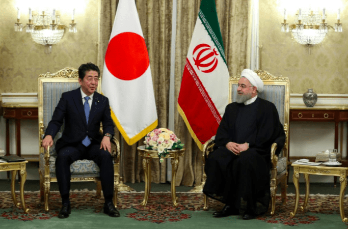 FILE PHOTO: Iranian President Hassan Rouhani with Japan's Prime Minister Shinzo Abe in Tehran, Iran, June 12, 2019. REUTERS