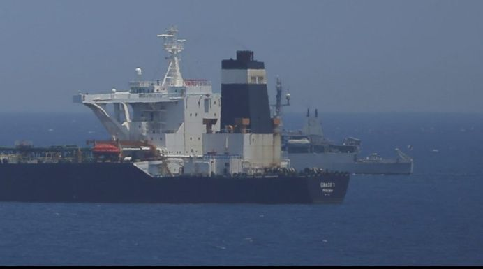 FILE PHOTO: A British Royal Navy patrol vessel guards the oil supertanker Grace 1. REUTERS/Jon Nazca