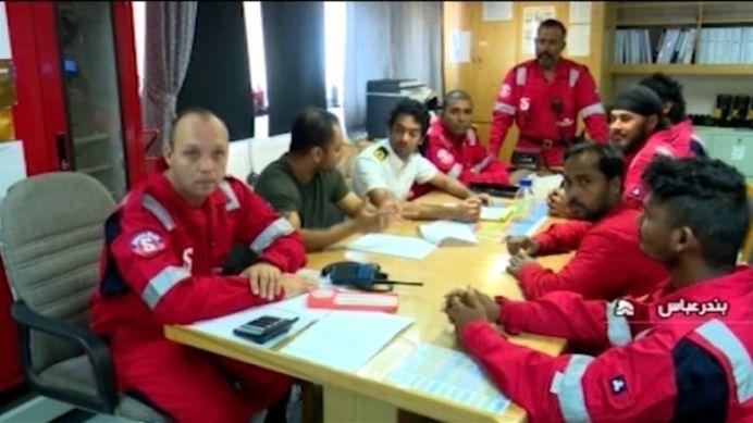Various of Crew Members of Stena Impero Tanker Sitting Around Table. REUTERS./