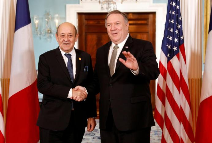 FILE PHOTO: U.S. Secretary of State Mike Pompeo meets French Foreign Minister Jean-Yves Le Drian during a gathering of foreign ministers aligned toward the defeat of Islamic State at the State Department in Washington, U.S., February 6, 2019. REUTERS/Kevin Lamarque