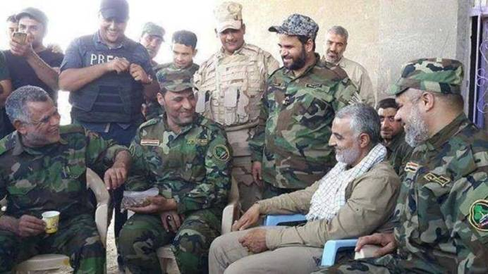 FILE PHOTO: Soleimani in a meeting with PMF's Hadi Al-Amiri. Source: Kayhan London