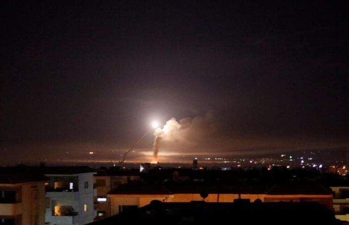 FILE PHOTO: Missile fire is seen from Damascus, Syria. REUTERS/Omar Sanadiki