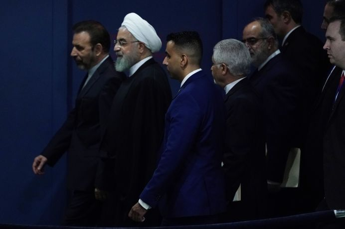 Iran's President Hassan Rouhani walks with his entourage through the General Assembly Hall during the 74th session of the United Nations General Assembly at U.N. headquarters in New York City, New York, U.S., September 25, 2019. REUTERS/Carlo Allegri