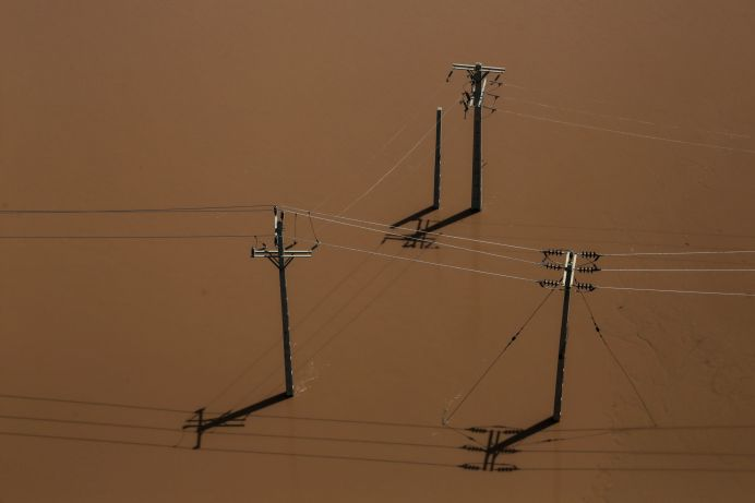 An aerial view showing electricity poles half-submerged in flood in Khuzestan province, Iran, April 5, 2019. file photo//REUTERS./