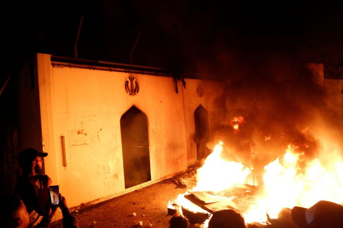 FILE PHOTO: Demonstrators set fire in front of the Iranian consulate, as they gather during ongoing anti-government protests in Najaf, Iraq November 27, 2019. REUTERS