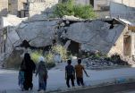 FILE PHOTO: People walk near rubble of damaged buildings in the city of Idlib, Syria May 27, 2019. Picture taken May 27, 2019. REUTERS/Khalil Ashawi