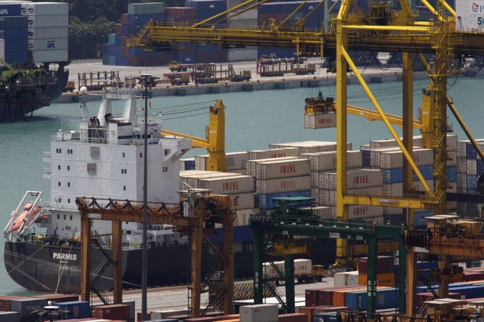 FILE PHOTO: The Parmis is loaded at a dock in Singapore. The IRISL ships and containers are key parts in an international cat-and-mouse game: Iran's attempt to evade the trade sanctions tightening around it. Washington and European capitals want to stop or slow Iran's nuclear programme. They believe that IRISL, which moves nearly a third of Iran's exports and imports and is central to the country's trade, plays a critical role in evading sanctions against shipping controlled weapons, missiles and nuclear technology to and from Iran.