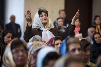 An Iranian Armenian woman prays during a mass prayer ceremony at a church in central Tehran. REUTERS./