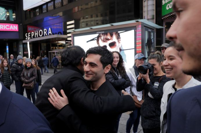Dropbox Inc. co-founder Arash Ferdowsi is congratulated by a co-worker as Dropbox (DBX) is listed for the company's initial public offering (IPO) at the Nasdaq Market Site in New York City, U.S., March 23, 2018. REUTERS/Lucas Jackson