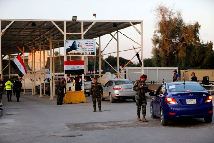 FILE PHOTO: Iraqi security forces gather at a checkpoint into the Green Zone in Baghdad, Iraq. REUTERS/Thaier al-Sudani