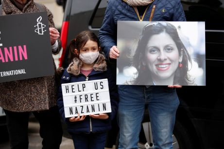Gabriella Ratcliffe, daughter of British-Iranian aid worker Nazanin Zaghari-Ratcliffe, protests outside the Iranian Embassy in London, Britain March 8, 2021. REUTERS/Andrew Boyers