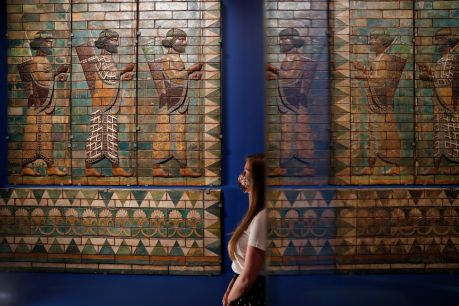 A V&A employee looks at copies of The King's Bodyguard. The originals were found in the Palace of Darius at Susa and will be on display at Epic Iran, an exhibition soon to open at the V&A in London, Britain, May 25, 2021. Picture taken May 25, 2021. REUTERS/Peter Nicholls