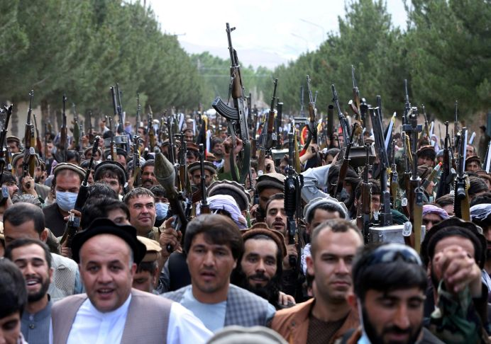 Hundreds of armed men attend a gathering to announce their support for Afghan security forces and that they are ready to fight against the Taliban, on the outskirts of Kabul, Afghanistan June 23, 2021. REUTERS/