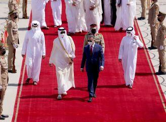 Iraqi Prime Minister Mustafa al-Kadhimi welcomes Qatar's Emir Sheikh Tamim bin Hamad al-Thani, upon his arrival at Baghdad International Airport, in Baghdad, Iraq, August 28, 2021. REUTERS./