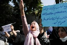 A woman raises her hand as she chants during the anti-Taliban/Pakistan protest in Kabul, Afghanistan, September 7, 2021. REUTERS./