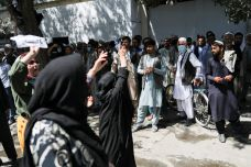 Female Afghan protesters chant towards a crowd of men during the anti-Pakistan protest in Kabul, Afghanistan, September 7, 2021. WANA (West Asia News Agency) via REUTERS ATTENTION EDITORS - THIS IMAGE HAS BEEN SUPPLIED BY A THIRD PARTY.