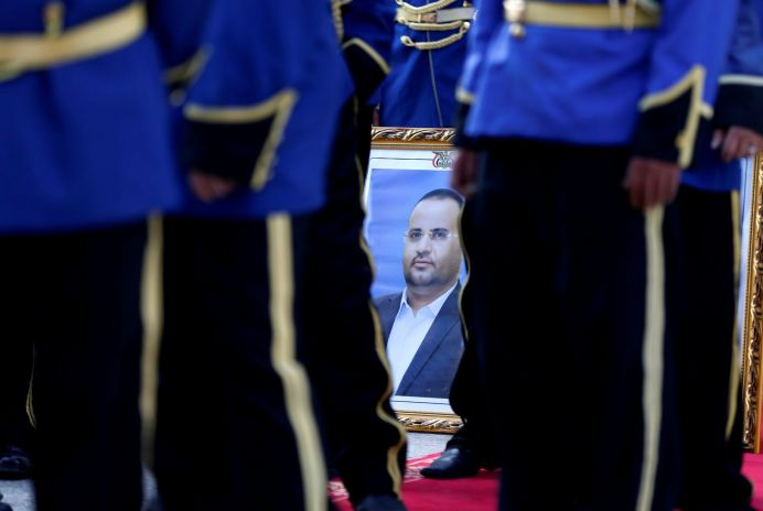 FILE PHOTO: A poster of Saleh al-Samad, a senior Houthi official, is held by a member of the honor guards during the funeral procession of al-Samad and his six body guards, who were killed by Saudi-led air strikes last week, in Sanaa, Yemen April 28, 2018. REUTERS/Khaled Abdullah