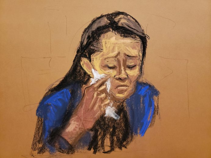 Huawei Chief Financial Officer Meng Wanzhou cries before a hearing in Brooklyn federal court, which Meng attended virtually from Canada, at Brooklyn's Federal District Court in a courtroom sketch in New York, U.S., September 24, 2021. REUTERS/Jane Rosenberg