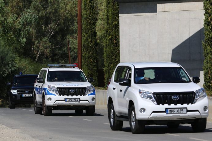 FILE PHOTO: Police vehicles leave a court, where a remand order was issued against a man suspected of plotting to murder Israeli businesspeople on the island, in Nicosia, Cyprus October 6, 2021. REUTERS/Yiannis Kourtoglou