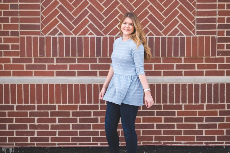 twirling in a striped tunic