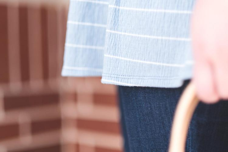 details of a striped tunic