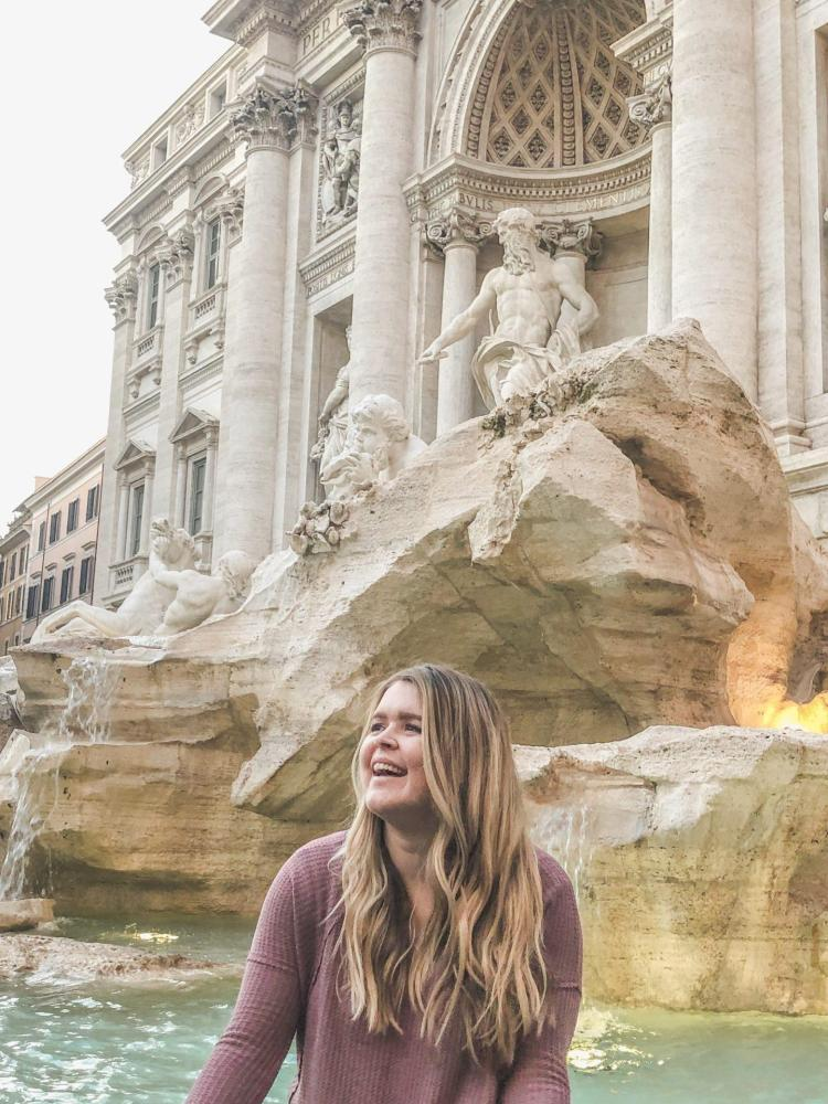 sitting in front of the trevi fountain in rome italy