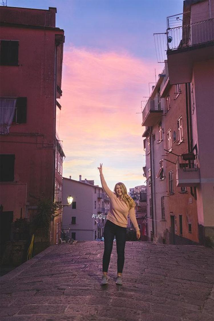 throwing up a peace sign in Riomaggiore Cinque Terre, Italy